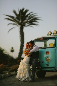 groom and bride cuddling in a boho vw before their wedding